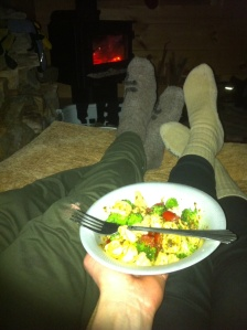Pesto tortellini with veggies in front of the fireplace